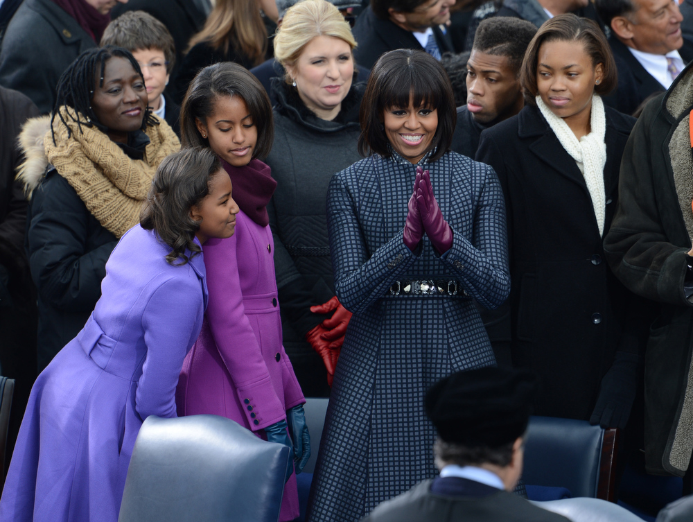 Description of . Sasha(L),Malia(C) and Michelle Obama arrive for cermonies in which US President Barack Obama will take the oath of office during the 57th Presidential Inauguration ceremonial swearing-in at the US Capitol on January 21, 2013 in Washington, DC. The oath is to be administered by Chief Justice John Roberts.  STAN HONDA/AFP/Getty Images