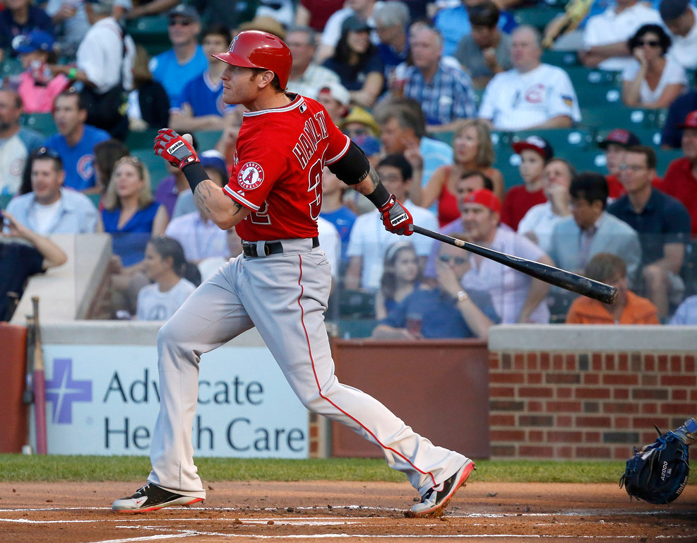 . Los Angeles Angels\' Josh Hamilton watches his three-run home run off Chicago Cubs starting pitcher Jeff Samardzija during the first inning of an interleague  baseball game Wednesday, July 10, 2013, in Chicago. (AP Photo/Charles Rex Arbogast)