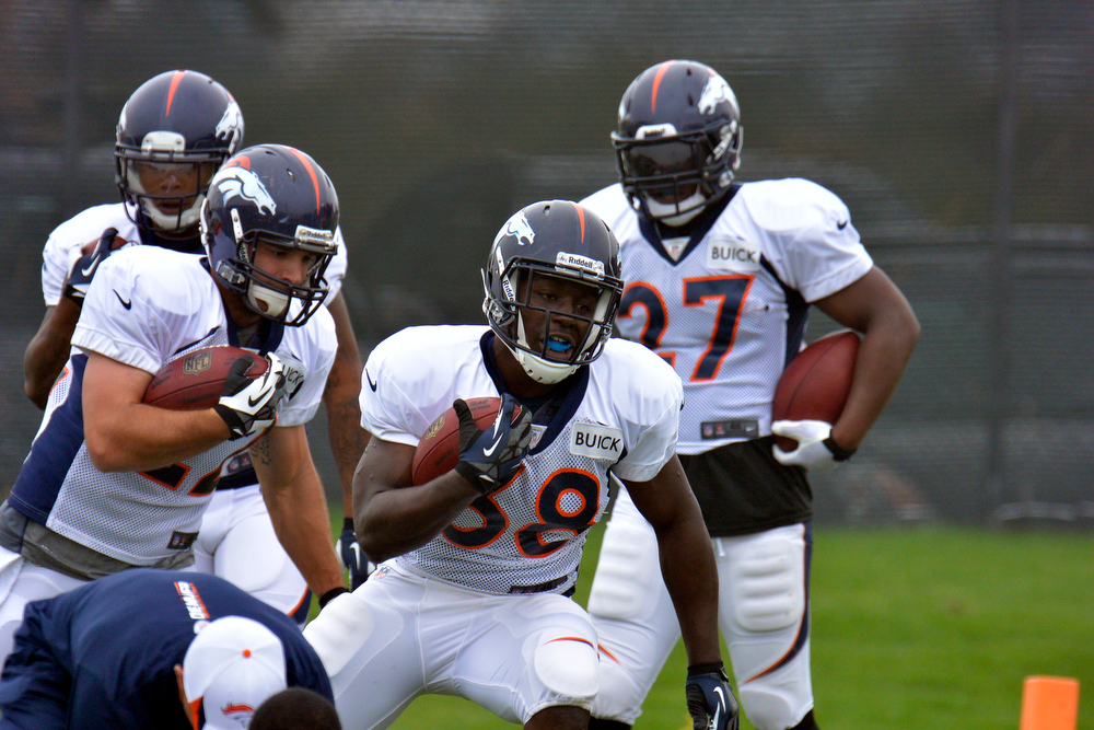 . Denver Broncos RB\'s Jacob Hester (22) Montee Ball (38) run through drills during training camp July 29, 2013 at Dove Valley. (Photo By John Leyba/The Denver Post)