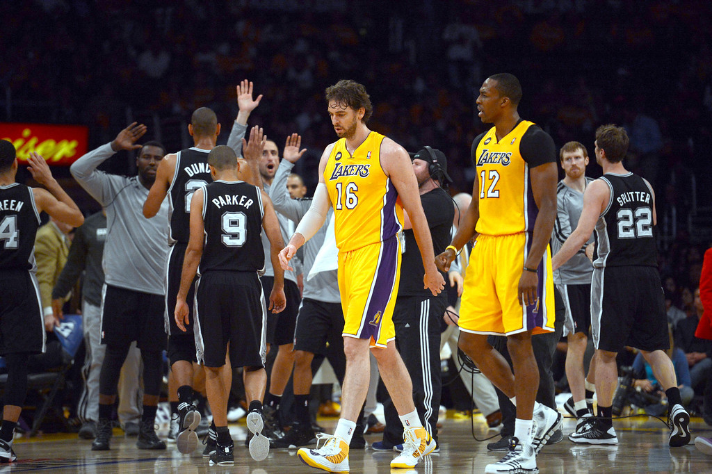. The Lakers\'  Pau Gasol #16 and Dwight Howard #12 walk off the court in the 3rd period during game three of their NBA Western Conference playoffs against the Spurs at the Staples Center Friday, April 26, 2013. The Spurs beat the Lakers 120-89. (Hans Gutknecht/L.A. Daily News)