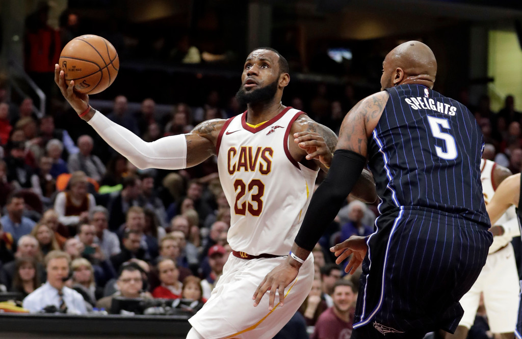 . Cleveland Cavaliers\' LeBron James (23) drives against Orlando Magic\'s Marreese Speights (5) in the first half of an NBA basketball game, Thursday, Jan. 18, 2018, in Cleveland. (AP Photo/Tony Dejak)