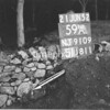 NJ910959A, Man marking Ordnance Survey minor control revision point with an arrow in 1950s