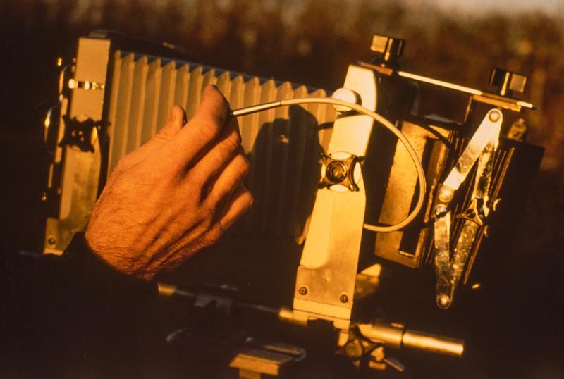 Closeup of view camera with compendium bellows sunshade.