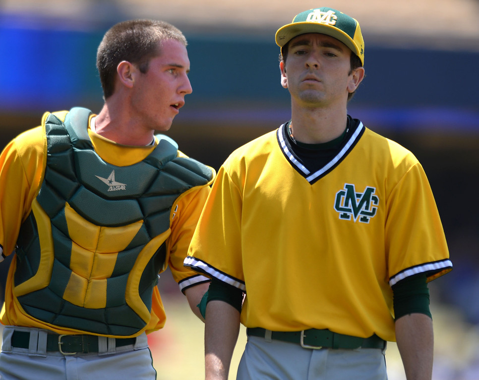 . Mira Costa pitcher Chris Alcala and catcher Austin Henning discuss the game between innings against Serra in the CIF-SS Division III championship baseball game Friday at Dodger Stadium. Serra won the title, 8-1. 20130531 Photo by Steve McCrank / Staff Photographer