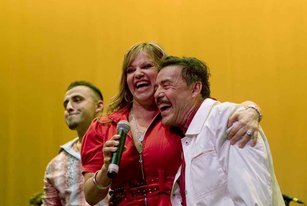 . Jenni Rivera, the Mexican-American singer and television star, performs during an event to honor her father, Don Pedro, right, at the Los Angeles Theater Center, in Los Angeles, May 21, 2009. A plane carrying Rivera crashed early in the morning on Dec. 9, 2012, Mexican officials said, adding that they feared there were no survivors. Her brother, Juan, left. (Eric Grigorian/The New York Times)