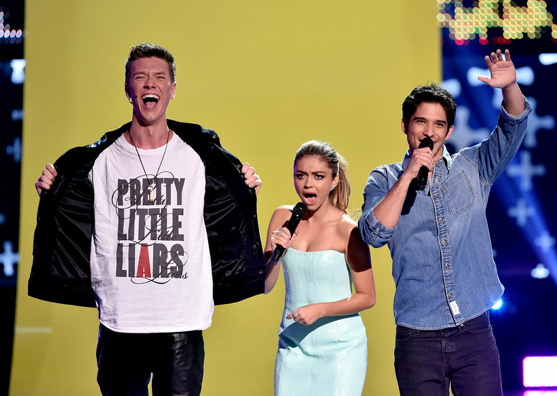 . (L-R) Actor Collins Key,  Hosts Tyler Posey and Sarah Hyland onstage during FOX\'s 2014 Teen Choice Awards at The Shrine Auditorium on August 10, 2014 in Los Angeles, California.  (Photo by Kevin Winter/Getty Images)