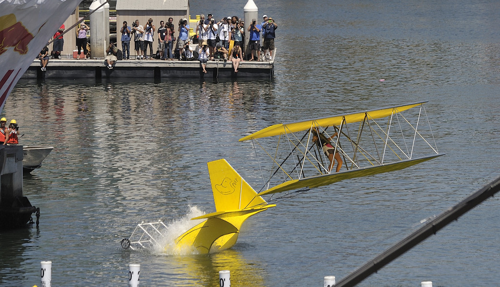 """. LONG BEACH, CALIF. USA -- Corinne Schnieders pilots her team\'s Flugtag entry \""""Peepin\' it Real\"""" 96 feet to win the event in Rainbow Harbor in Long Beach, Calif. on August 21, 2010. Thirty five teams competed in the Red Bull event where teams build homemade, human-powered flying machines and pilot them off a 30-foot high deck in hopes of achieving flight.  Flugtag means \""""flying day\"""" in German. They are on distance, creativity and showmanship..Photo by Jeff Gritchen / Long Beach Press-Telegram.."""