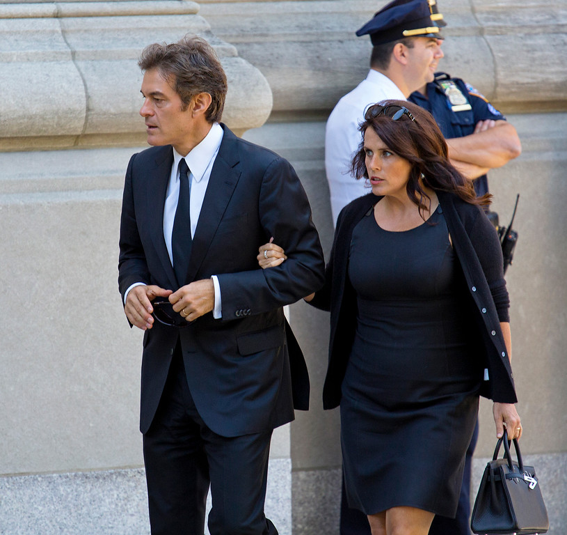 . Dr. Memhet Oz, left, and his wife Lisa Oz, arrive at a funeral service for comedian Joan Rivers at Temple Emanu-El in New York Sunday, Sept. 7, 2014. Rivers died Thursday, Sept. 4, 2014. She was 81. (AP Photo/Craig Ruttle)