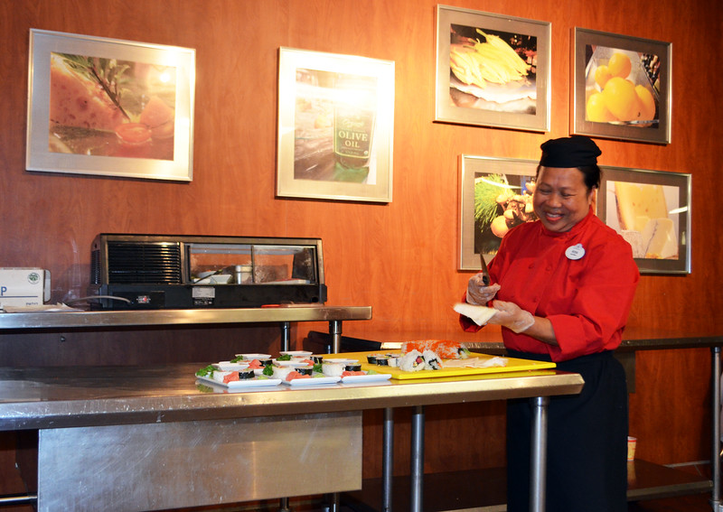 Day 1: Chef Rosa prepares sushi during Adventures by Disney welcome dinner at Walt Disney World's Contemporary Resort show kitchen, photo by Dave Parfitt