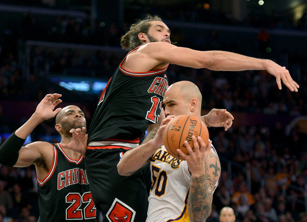 . Chicago Bulls\' Taj Gibson, left, and Noakim Noah,center, battle Lakers\' Robert Sacre in the NBA basketball game at Staples Center in Los Angeles, CA. on Sunday, February 9, 2014. (Photo by Sean Hiller/ Daily Breeze).