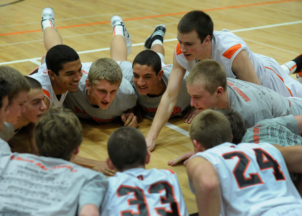 . The Rangers huddled on the court before the game. The Lewis-Palmer High School boy\'s basketball team defeated Broomfield 75-53 Friday night, December 7, 2012.  Karl Gehring/The Denver Post