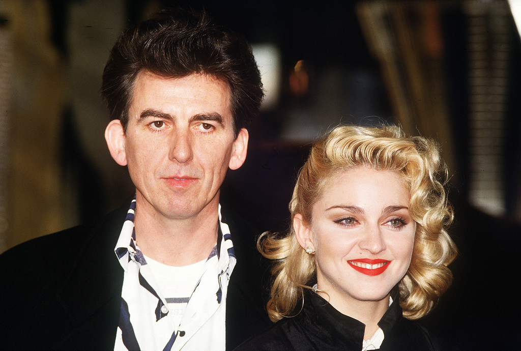 """. U.S. pop singer and actress Madonna and former Beatles guitarist George Harrison publicise the movie \""""Shanghai Surprise\"""" in London in March 1986. Harrison has produced the movie in which Madonna stars. (AP Photo/Peter Kemp)"""