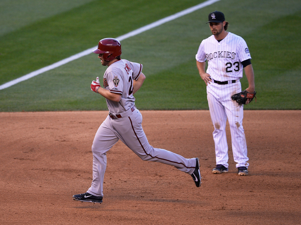 . Colorado Rockies shortstop Charlie Culberson (23) watches as Arizona Diamondbacks first baseman Nick Evans (28) rounds third base after hitting a home run in the 4th inning off Colorado Rockies starting pitcher Jorge De La Rosa (29) June 3, 2014 at Coors Field. (Photo by John Leyba/The Denver Post)