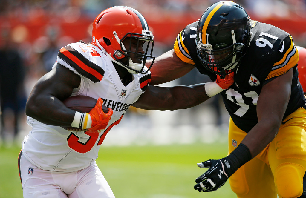 . Cleveland Browns running back Isaiah Crowell (34) is driven out of bounds by Pittsburgh Steelers defensive end Stephon Tuitt (91) in the first half of an NFL football game, Sunday, Sept. 10, 2017, in Cleveland. (AP Photo/Ron Schwane)