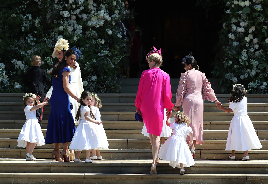 . Kate, the Duchess of Cambridge, foreground left and Jessica Mulroney arrive with the bridesmaids for the wedding ceremony of Prince Harry and Meghan Markle at St. George\'s Chapel in Windsor Castle in Windsor, near London, England, Saturday, May 19, 2018. (Jane Barlow/pool photo via AP)