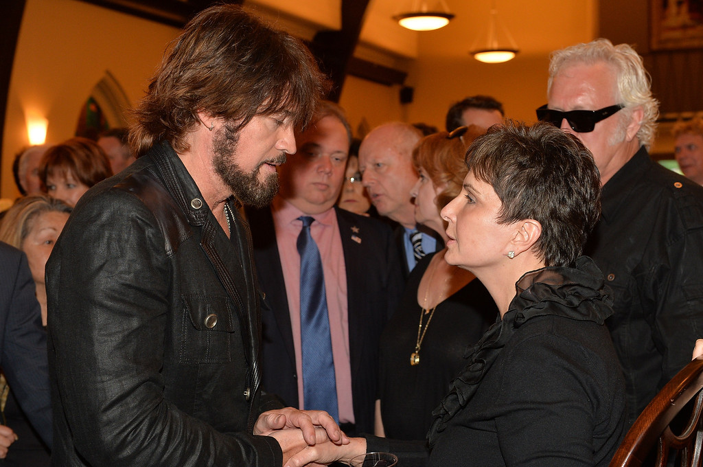 . Country musician Billy Ray Cyrus and Nancy Jones attend the private visitation for George Jones on May 1, 2013 in Nashville, Tennessee.  (Photo by Rick Diamond/Getty Images for Nancy Jones)