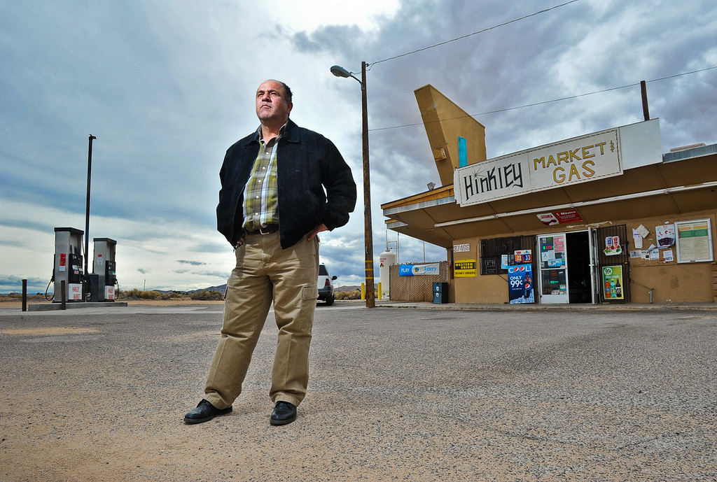 . Ali Abu Hantash, owner of Hinkley Market & Gas, gazes off into the distance as he stands in front of his empty general store in Hinkley, Calif. on Thursday, March 7, 2013. Hantash is struggling to keep Hinkley\'s only retail business open, and said he sees no hope in his future nor his ability to save his store due Hinkley\'s dwindling population. (Rachel Luna / San Bernardino Sun)