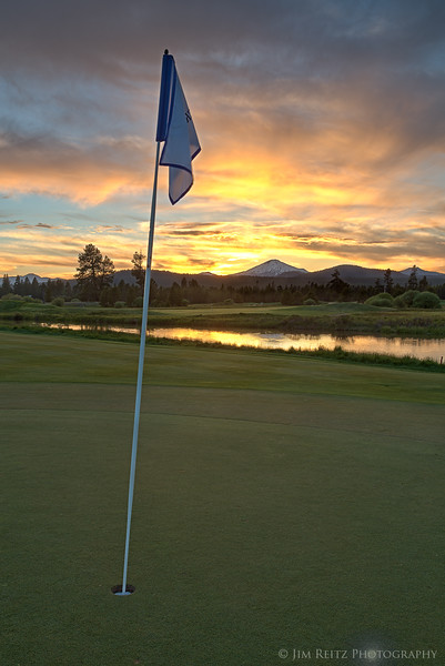 Sunset behind the 18th green at Crosswater golf course - at Sunriver, Oregon