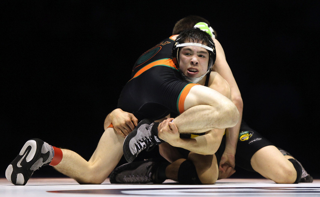 . Live Oak\'s Isaiah Locsin, bottom, wrestles Porterville\'s Mason Pengilly in the 120-pound championship match during the California Interscholastic Federation wrestling championships in Bakersfield, Calif., on Saturday, March 2, 2013. Pengilly won the match 5-3. (Anda Chu/Staff)