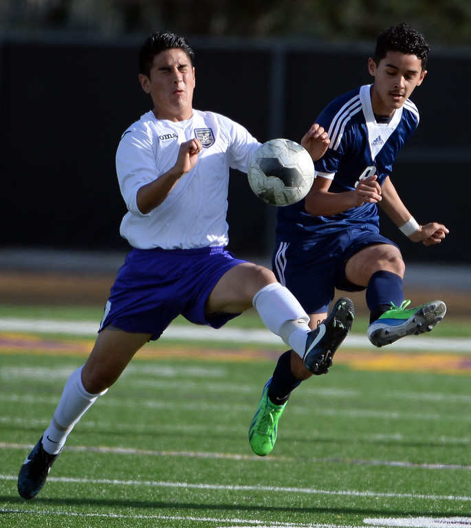 . Diamond Bar\'s Andrew Holguin (7) controls the ball past Baldwin Park\'s Eduardo Suarez (9) in the first half of a CIF-SS quarterfinal prep playoff soccer match at Diamond Bar High School in Diamond Bar, Calif., on Thursday, Feb.27, 2014. Baldwin Park won 2-1. (Keith Birmingham Pasadena Star-News)