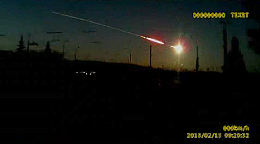 Description of . In this frame grab made from dashboard camera video, a meteor streaks through the sky over Chelyabinsk, about 1500 kilometers (930 miles) east of Moscow, Friday, Feb. 15, 2013. With a blinding flash and a booming shock wave, the meteor blazed across the western Siberian sky Friday and exploded with the force of 20 atomic bombs, injuring more than 1,000 people as it blasted out windows and spread panic in a city of 1 million. (AP Photo/AP Video)