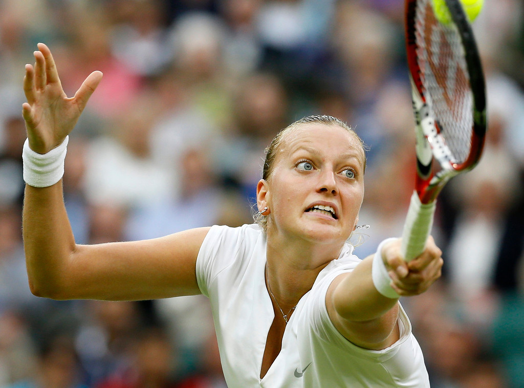 . Petra Kvitova of the Czech Republic plays a return to Kirsten Flipkens of Belgium in their Women\'s singles quarterfinal match at the All England Lawn Tennis Championships in Wimbledon, London, Tuesday, July 2, 2013. (AP Photo/Kirsty Wigglesworth)