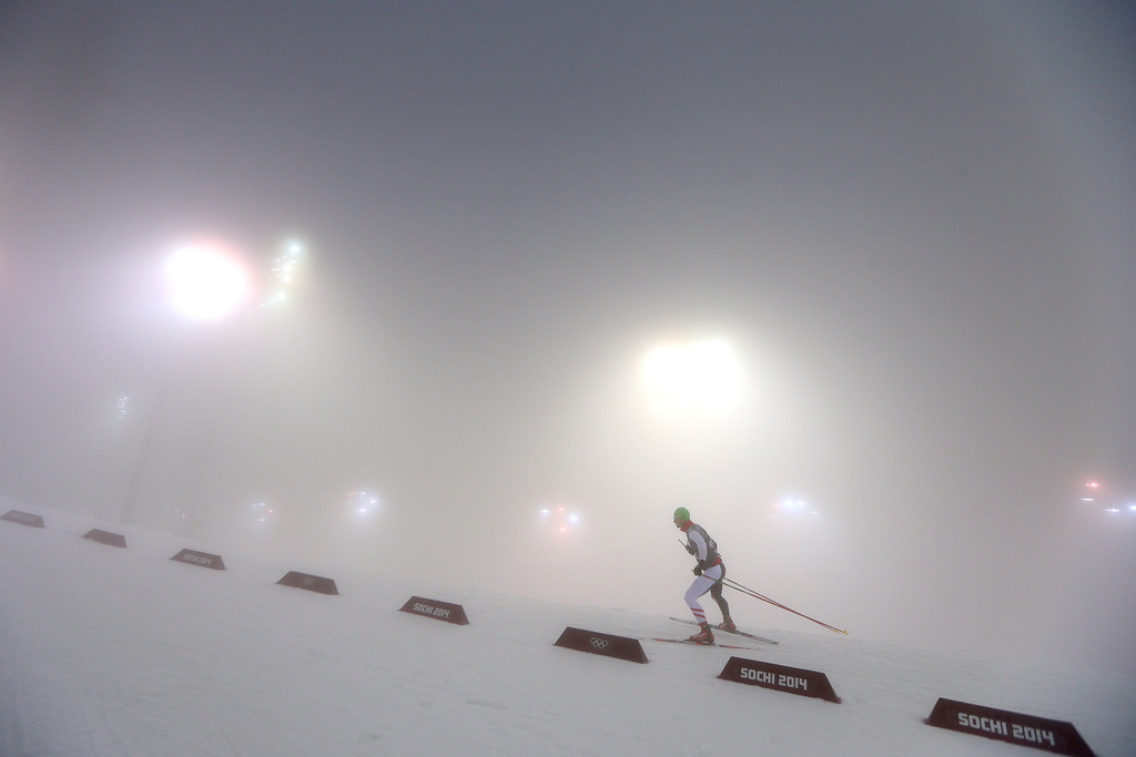 . A biathlete warms up for in the Men\'s 15 km Mass Start during day nine of the Sochi 2014 Winter Olympics at Laura Cross-country Ski & Biathlon Center on February 16, 2014 in Sochi, Russia.  (Photo by Clive Mason/Getty Images)