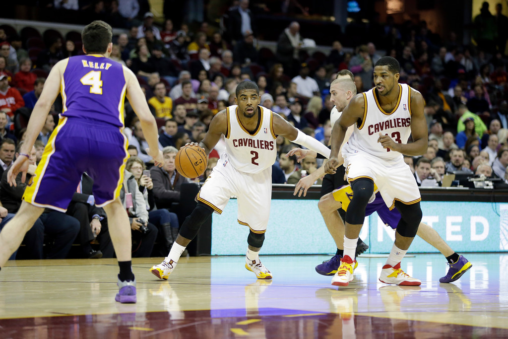 . Cleveland Cavaliers\' Kyrie Irving (2) against the Los Angeles Lakers in an NBA basketball game Wednesday, Feb. 5, 2014, in Cleveland. (AP Photo/Mark Duncan)