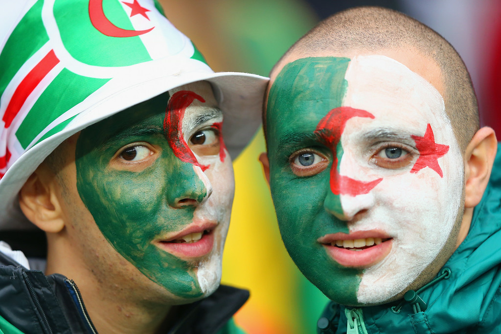 . Algeria fans enjoy the atmosphere prior to the 2014 FIFA World Cup Brazil Round of 16 match between Germany and Algeria at Estadio Beira-Rio on June 30, 2014 in Porto Alegre, Brazil.  (Photo by Jamie Squire/Getty Images)
