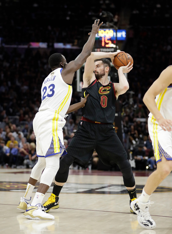 . Cleveland Cavaliers\' Kevin Love is defended by Golden State Warriors\' Draymond Green in the second half of Game 4 of basketball\'s NBA Finals, Friday, June 8, 2018, in Cleveland. (AP Photo/Tony Dejak)