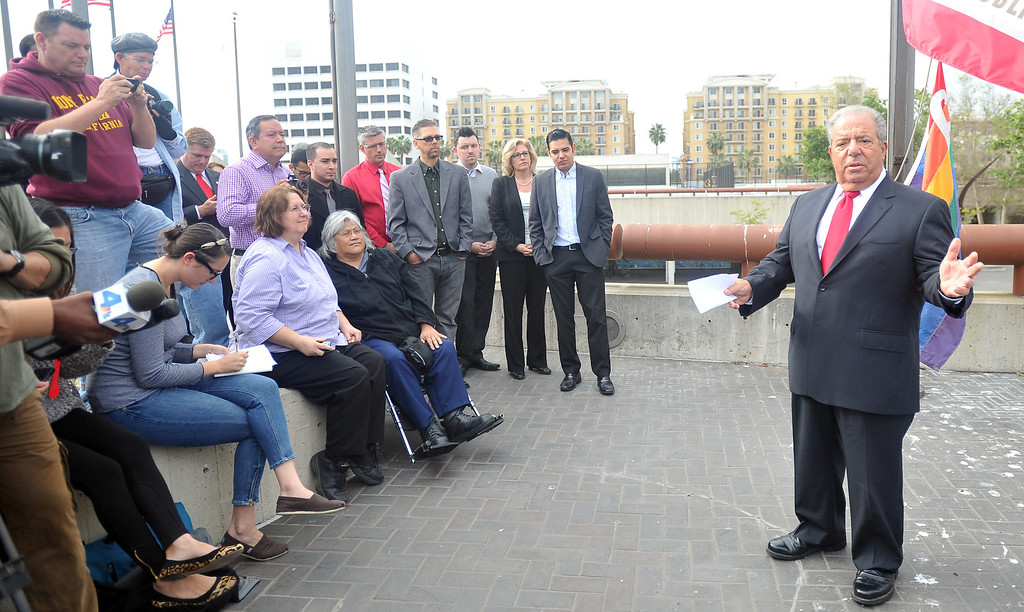 . 3/26/13 - Long Beach Mayor Bob Foster speaks to the crowd before raising the gay pride flag Tuesday in recognition of the U.S. Supreme Court hearing taking place in Washington, D.C. Many from the LGBT came for the raising and cheered as the flag was raised. Photo by Brittany Murray / Staff Photographer