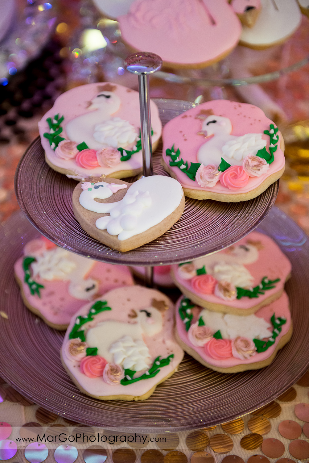 cookies decorated with pink frosting and white swans at Newark Oasis Palace