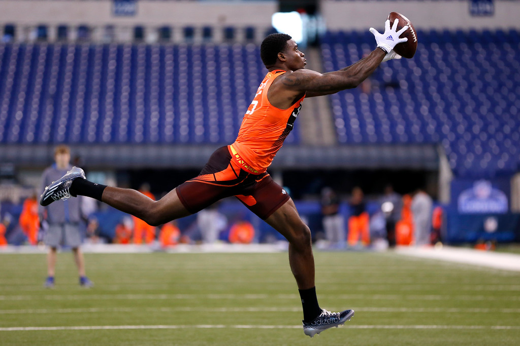 . Louisville wide receiver Devante Parker runs a drill at the NFL football scouting combine in Indianapolis, Saturday, Feb. 21, 2015. (AP Photo/Julio Cortez)