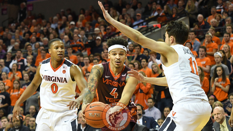 Virginia Tech Hokies guard Seth Allen (4) drives to the basket between Virginia Cavaliers guard Devon Hall (0) and guard Ty Jerome (11). (Michael Shroyer/ TheKeyPlay.com)