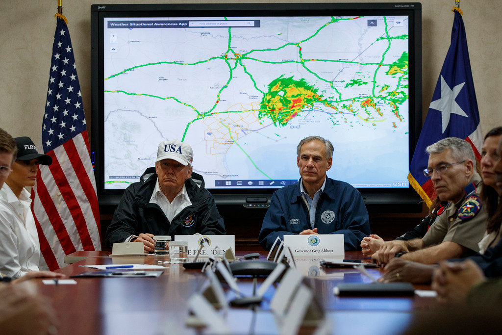 . President Donald Trump, accompanied by Texas Gov. Greg Abbott, speaks during a briefing on Harvey relief efforts, Tuesday, Aug. 29, 2017, at the the Texas Department of Public Safety Emergency Operations Center in Austin, Texas. (AP Photo/Evan Vucci)
