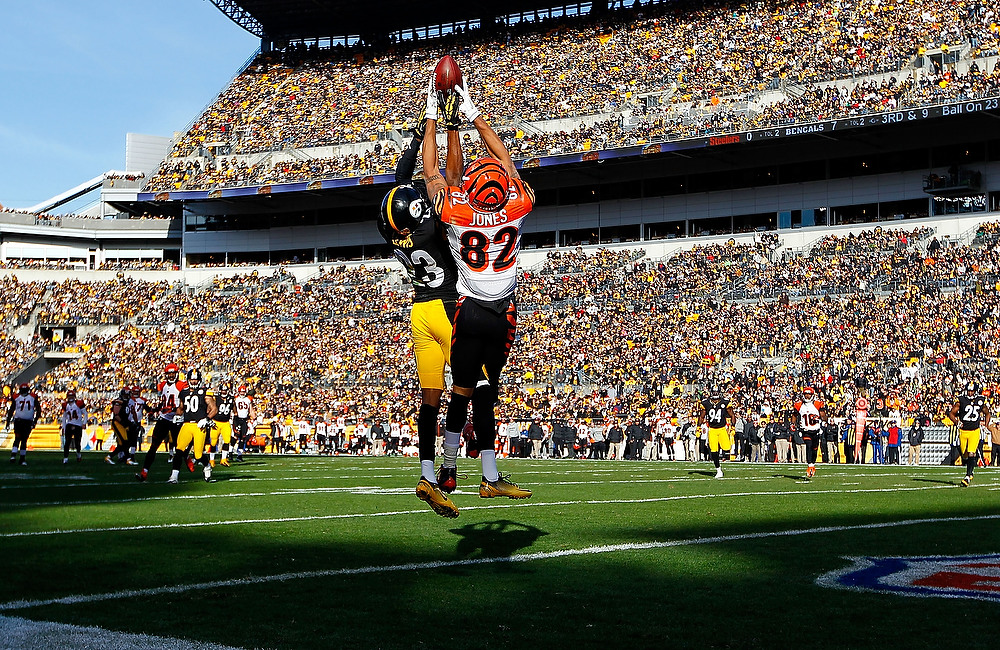 . Marvin Jones #82 of the Cincinnati Bengals goes up to catch a pass in the end zone before having it knocked loose by defender Keenan Lewis #23 of the Pittsburgh Steelers in the first half during the game at Heinz Field on December 23, 2012 in Pittsburgh, Pennsylvania. (Photo by Jared Wickerham/Getty Images)