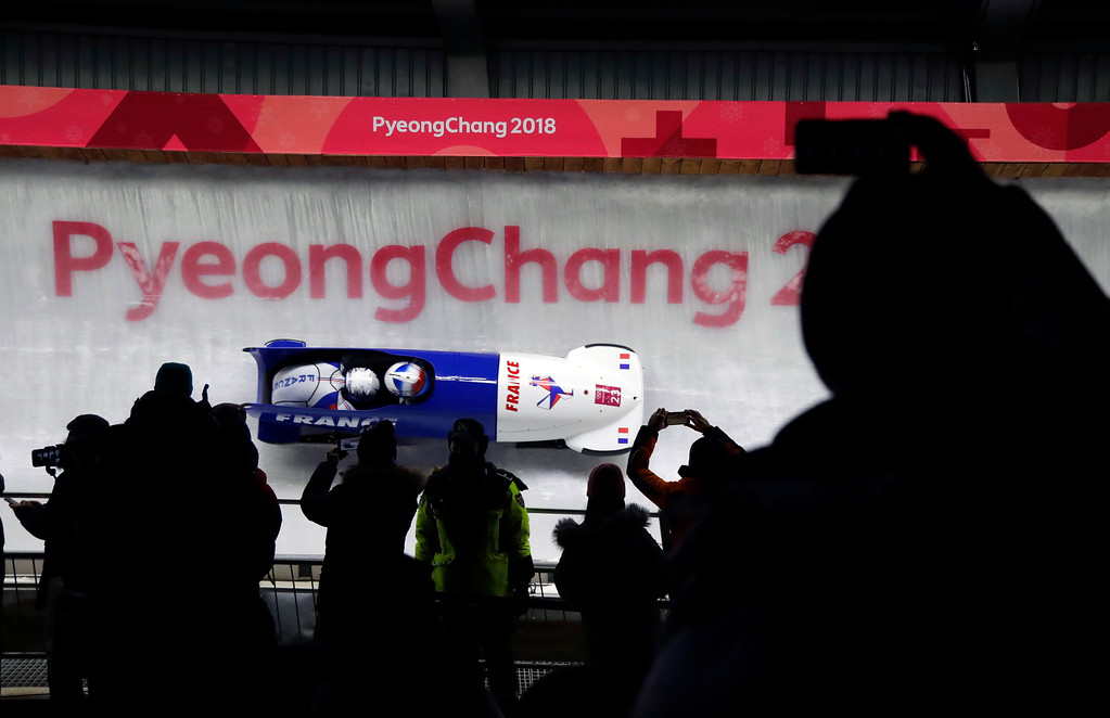 . Driver Romain Heinrich Dorian Hauterville of France take a curve in the second run during the two-man bobsled competition at the 2018 Winter Olympics in Pyeongchang, South Korea, Sunday, Feb. 18, 2018. (AP Photo/Wong Maye-E)