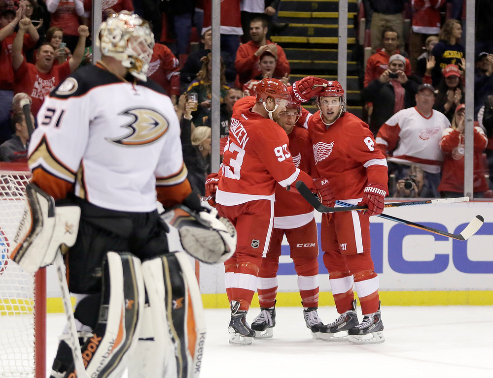 . Anaheim Ducks goalie Frederik Andersen (31), of Denmark, stands at the goal as Detroit Red Wings\' Luke Glendening is congratulated by teammates Johan Franzen (93), of Sweden, and Justin Abdelkader (8) during the second period of an NHL hockey games Saturday, Oct. 11, 2014, in Detroit. (AP Photo/Duane Burleson)