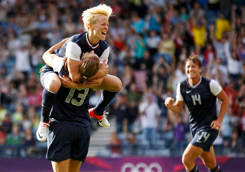 ". Alex Morgan (13) of the U.S. celebrates with team mate Megan Rapinoe (top) after scoring her second, and the fourth goal for the U.S against France during their women\'s Group G football match at the London 2012 Olympic Games at Hampden Park in Glasgow, Scotland July 25, 2012. The U.S. beat France 4-2. ""Olympics 2012\"" ranked as Google\'s third most searched trending event of 2012. REUTERS/David Moir"