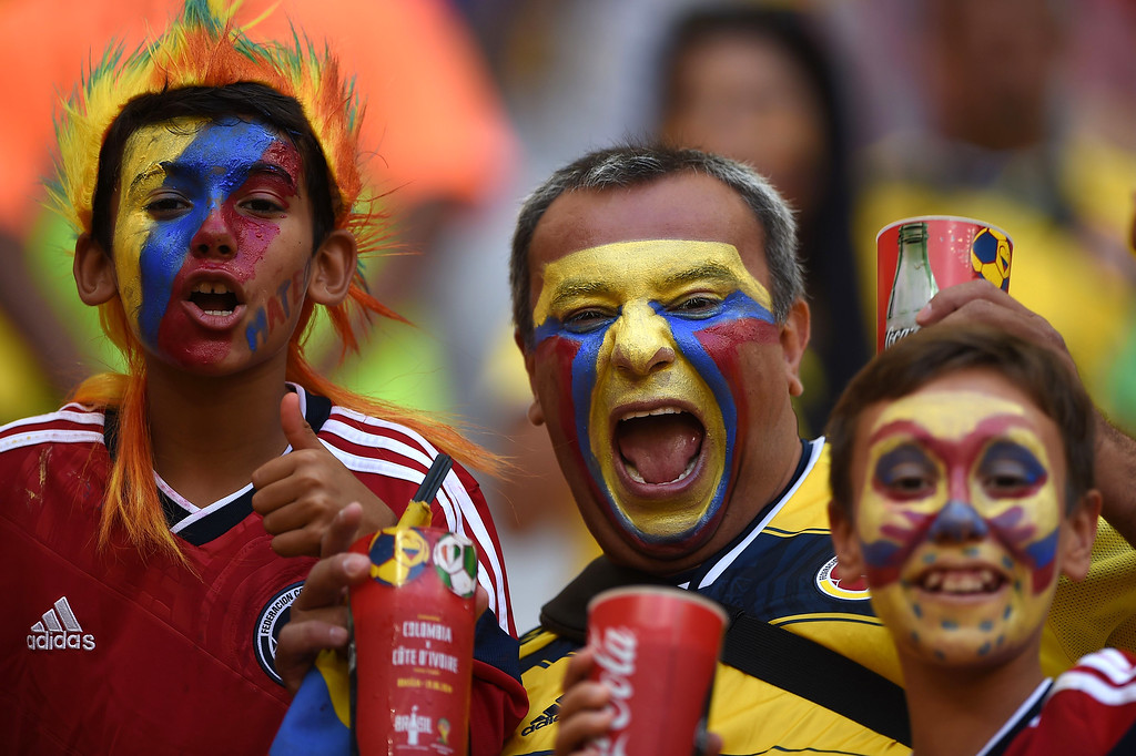 . Colombian fans cheer for their team during the Group C football match between Colombia and Ivory Coast at the Mane Garrincha National Stadium in Brasilia during the 2014 FIFA World Cup on June 19, 2014. AFP PHOTO / EITAN  ABRAMOVICH/AFP/Getty Images