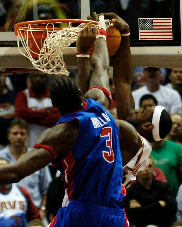 . Ken Blaze/KBlaze@News-Herald.com Detroit\'s Ben Wallace fouls LeBron James as he tries to slam dunk Friday at the Q.