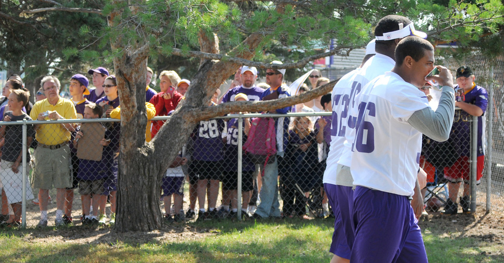 . Vikings players pass by a crowd of fans on their way to the practice field.   (Pioneer Press: John Doman)