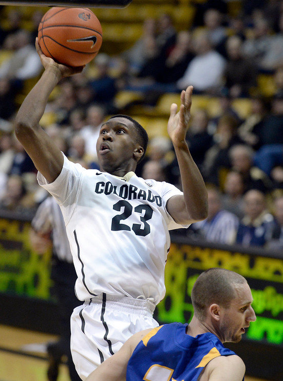 . University of Colorado\'s Jaron Hopkins takes a shot over Kyle Boswell during a game against  the University of California Santa Barbara, on Nov. 20, at the Coors Event Center in Boulder.  (Jeremy Papasso/Boulder Daily Camera)