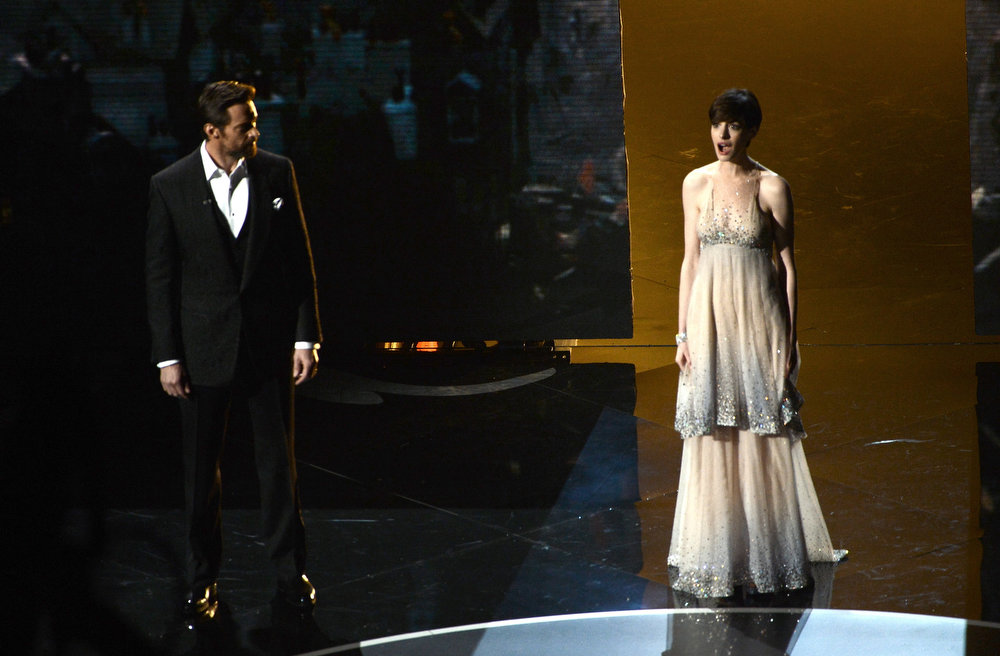 Description of . Actor Hugh Jackman and actress Anne Hathaway perform onstage during the Oscars held at the Dolby Theatre on February 24, 2013 in Hollywood, California.  (Photo by Kevin Winter/Getty Images)