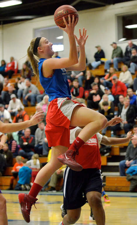 . Jeff Forman/JForman@News-Herald.com Kayla Gabor goes up for a shot during the 36th News-Herald Classic March 29 at Lakeland Community College.