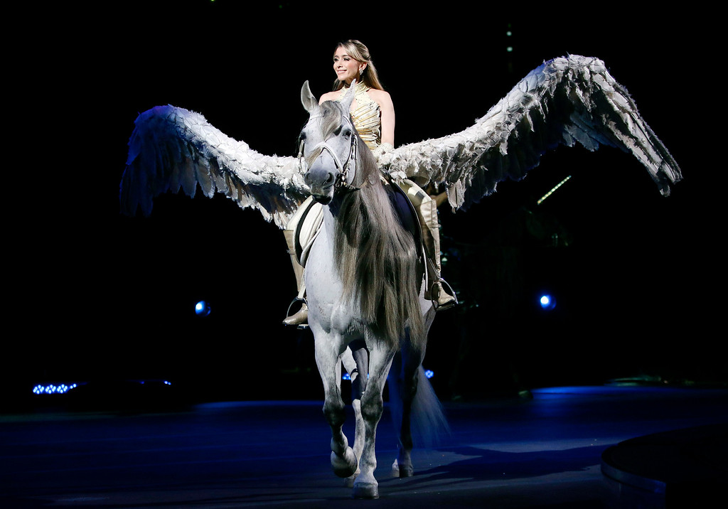 ". Tatiana Tchalabaev performs with ""Pegasus\"" Sunday, May 1, 2016, in Providence, R.I., during the show where Asian elephants made their final performance in the Ringling Bros. and Barnum & Bailey Circus.  (AP Photo/Bill Sikes)"