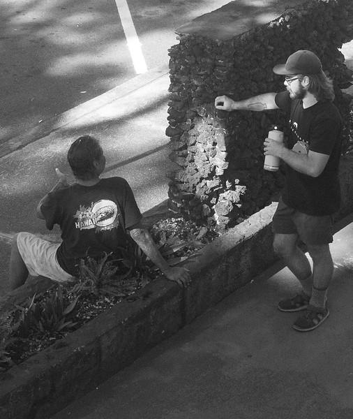 harmony in hawaii. a poor hawaiian talks to a ywamer outside ships base.