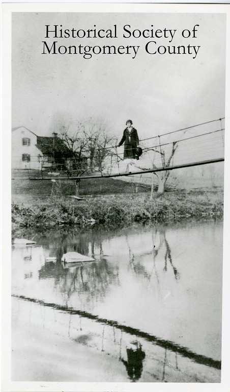 . Grace Swartley, later known as Mrs. Samuel Bean, is seen on the Evansburg Swinging Bridge in this undated photo from the Historical Society of Montgomery County. The bridge was destroyed in a 1935 flood.