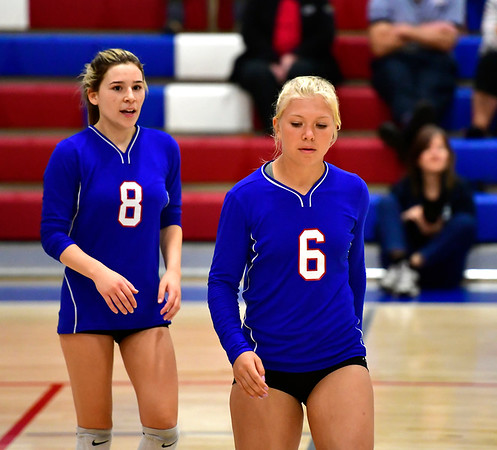 10/11/2019 Mike Orazzi | StaffrSt. Paul's Alexis Carabetta (8) and Ava Hampton (6) during Thursday night's girls volleyball match in Bristol. rr