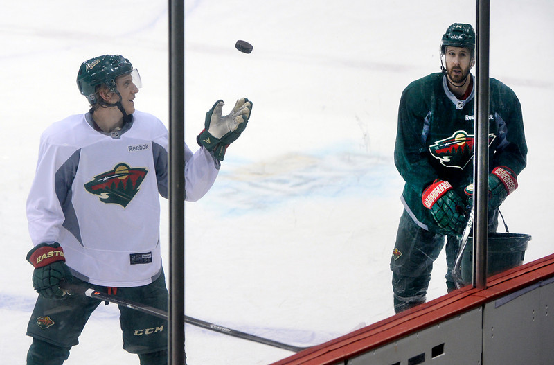 . Minnesota Wild defenseman Jonas Brodin, left, and right wing Justin Fontaine, right, collected pucks after practice Wednesday morning, April 23, 2014. (Photo by Karl Gehring/The Denver Post)